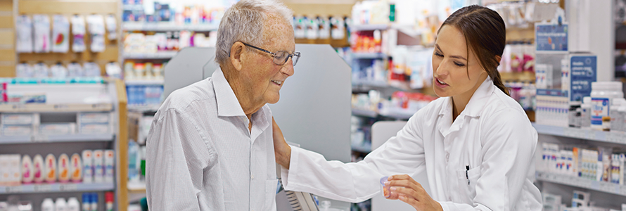 pharmacist with patient and prescription