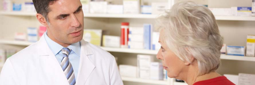 Photo of pharmacist talking with elderly customer