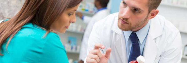 Pharmacist talking with patient