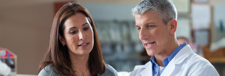 male pharmacist and female customer