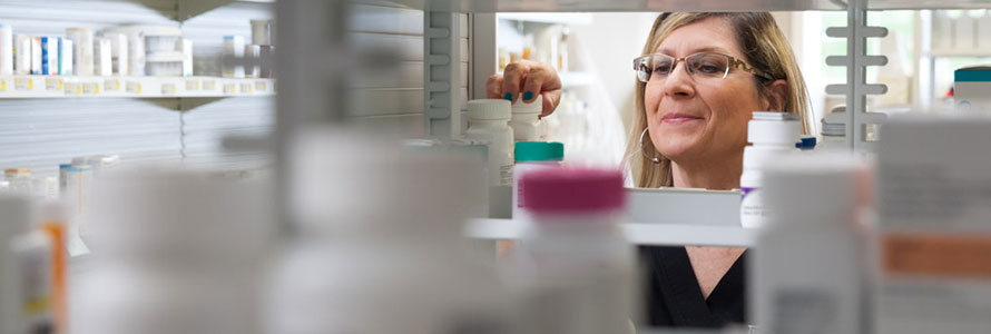 Pharmacists selecting bottle